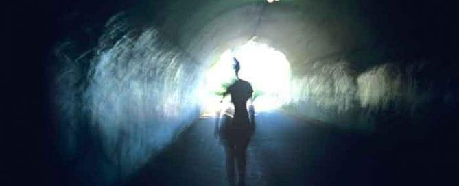 Man moving through tunnel of light